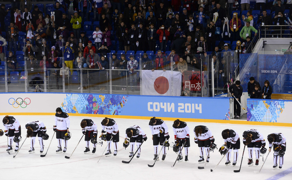 . Japan\'s players salute their supporters after being defeated in the Women\'s Ice Hockey 5th-8th place classifications match between Germany and Japan at the Shayba Arena during the Sochi Winter Olympics on February 18, 2014. Germany won 3-2. (JONATHAN NACKSTRAND/AFP/Getty Images)