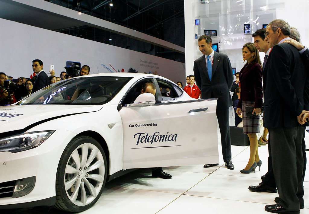 . The Prince of Spain, Felipe de Borbon (C) and his wife Leticia Ortiz (3R) are shown a fully connected car during their visit to the Telefonica Stand at the Mobile World Congress in Barcelona, on February 24, 2014.  The Mobile World Congress runs from the 24 to 27 February where participants and visitors alike can attend conferences, network, discover cutting-edge products and technologies at among the 1,700 exhibitors as well as seek industry opportunities and make deals.    QUIQUE GARCIA/AFP/Getty Images
