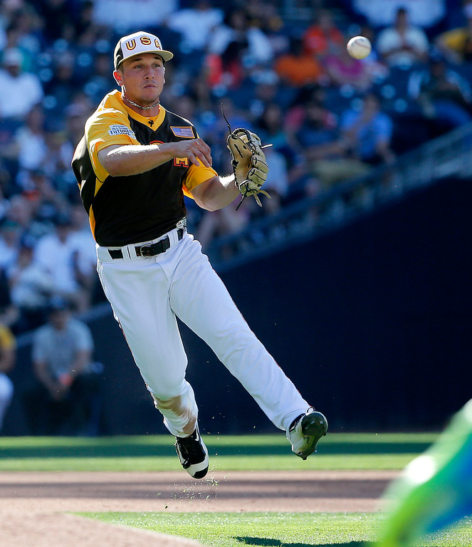 . U.S. Team\'s Alex Bregman, of the Houston Astros, throws to first against the World Team during the  inning of the All-Star Futures baseball game, Sunday, July 10, 2016, in San Diego. (AP Photo/Lenny Ignelzi)