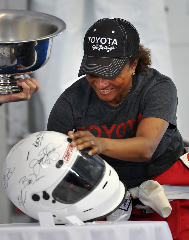 . 4/9/13 - Wanda Sykes autographs a helmet for auction, during media day for the 39th Annual Toyota Grand Prix of Long Beach. The celebrity/pro races spent the day practicing on the track, joking with their racing partners and giving interviews. Photo by Brittany Murray / Staff Photographer