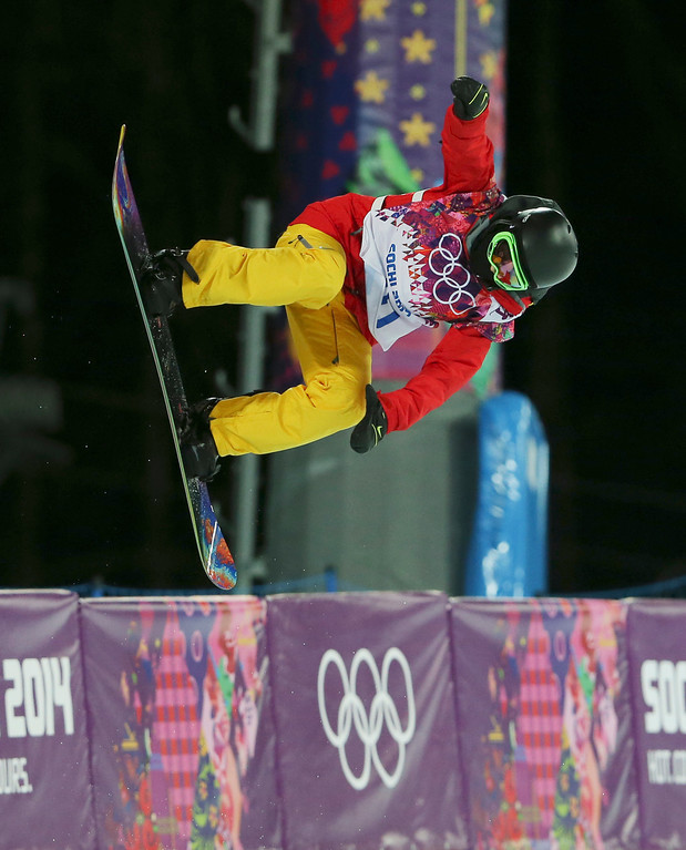 . China\'s Cai Xuetong competes during the women\'s snowboard halfpipe final at the Rosa Khutor Extreme Park, at the 2014 Winter Olympics, Wednesday, Feb. 12, 2014, in Krasnaya Polyana, Russia. (AP Photo/Sergei Grits)