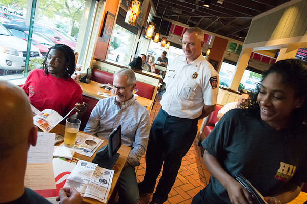 09/25/19 Wesley Bunnell | StaffrrTip a Firefighter took pace at Chili's in New Britain on Wednesday night. The event raised money for the city 's partnership with the community foundation regarding the new disaster relief program. Deputy Chief Michael Berry, R, assists in taking dinner orders.