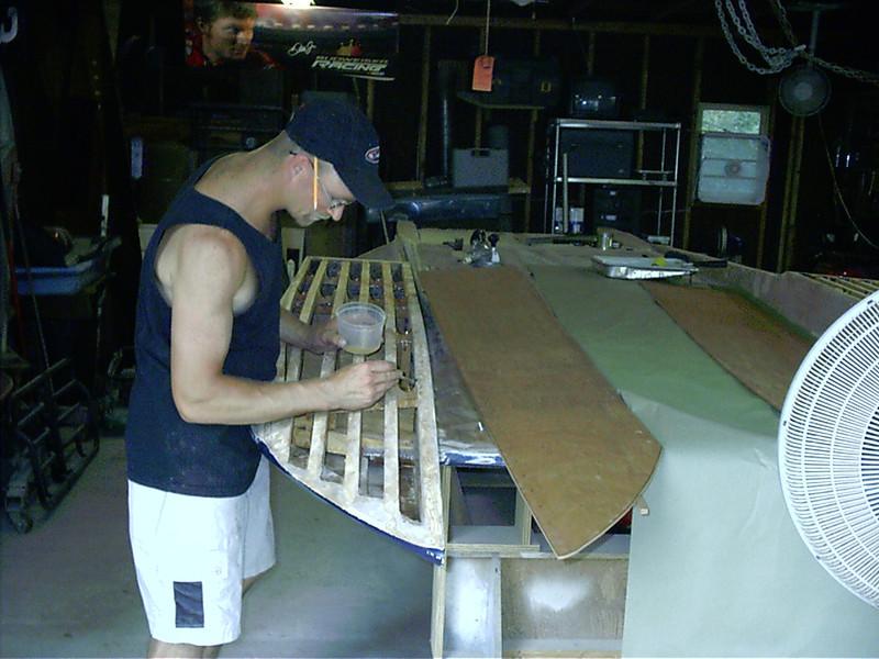 Coating between battens before installing new sponson bottom.