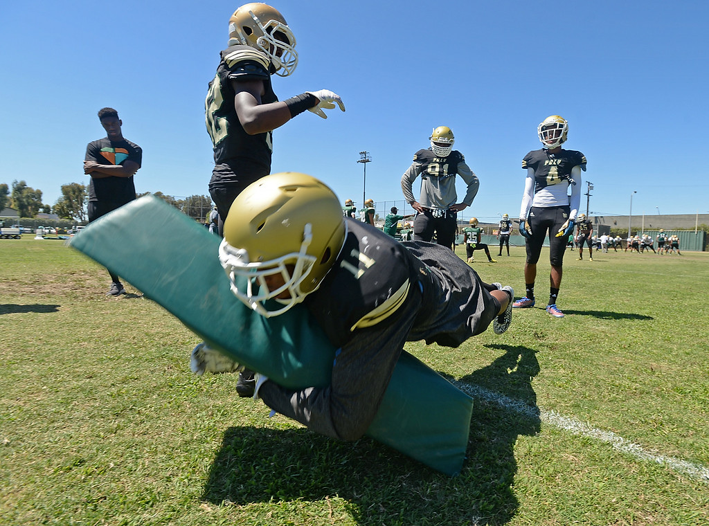 ". All American defensive back Iman ""Biggie\"" Marshall during tackling drills at Long Beach Poly football practice Saturday, August 16, 2014, Long Beach, CA.   Photo by Steve McCrank/Daily Breeze"
