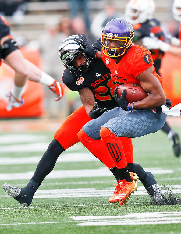 . South cornerback Arthur Maulet (28), of Memphis, tackles North squad wide receiver Zay Jones (7), of East Carolina, during the second half of the Senior Bowl college football game, Saturday, Jan. 28, 2017, at Ladd�Peebles Stadium, in Mobile, Ala. The South won 16-15. (AP Photo/Brynn Anderson)