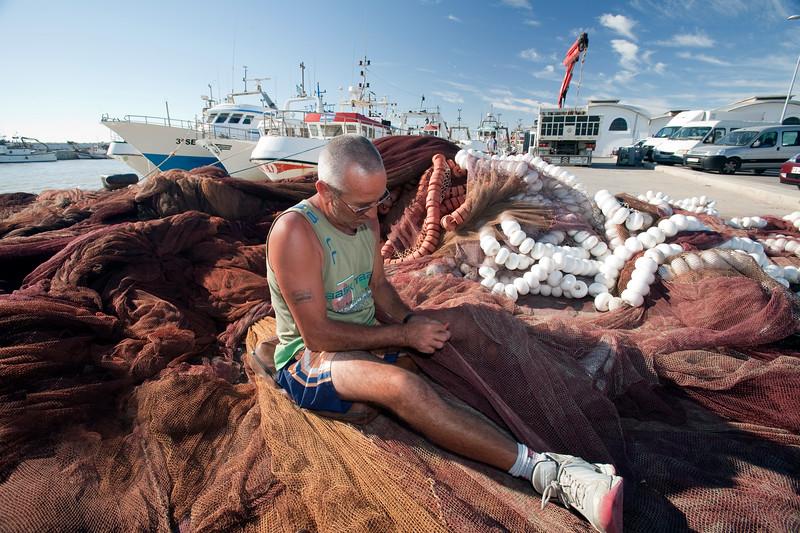 Fisherman fixing the nets. Bonanza port, town of Sanlucar de Barrameda, province of Cadiz, Andalusia, Spain.
