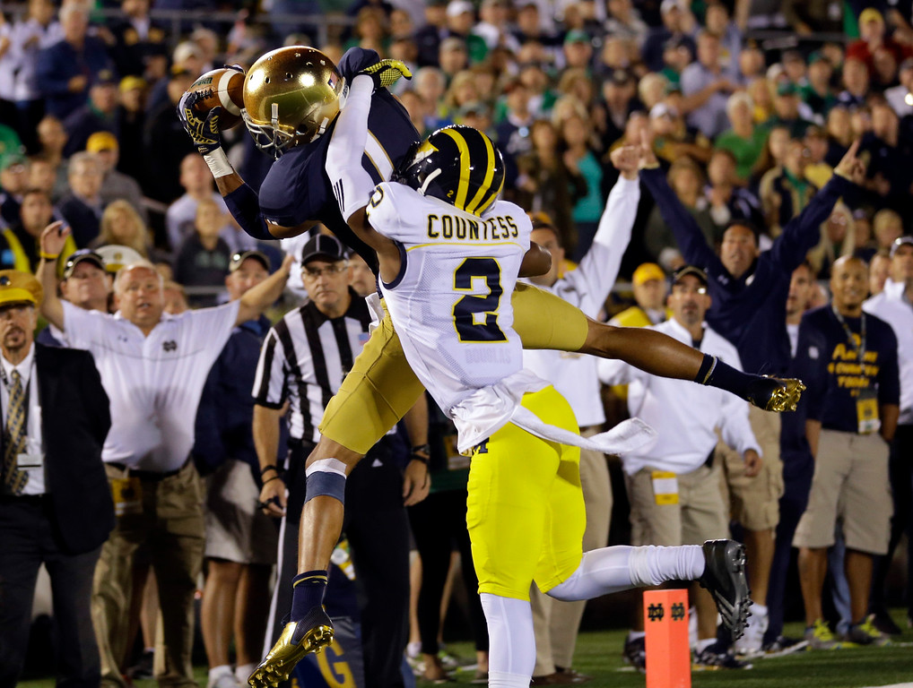 . Notre Dame wide receiver William Fuller makes a catch for a touchdown in front of Michigan defensive back Blake Countess (2) during the first half of an NCAA college football game in South Bend, Ind., Saturday, Sept. 6, 2014. (AP Photo/Michael Conroy)