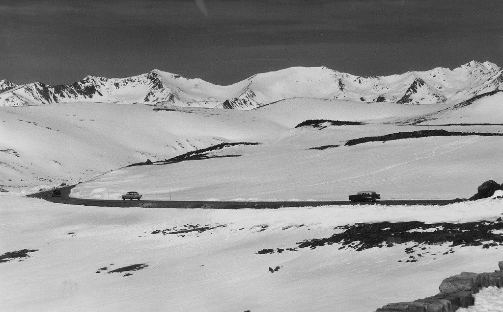 . Cars begin their ribbon-like route to the sky on Trail Ridge Road northwest of Estes Park in 1957. Only the road is free from snow, which is finally beginning to melt at full rate as summer arrives. (David Mathias/The Denver Post)
