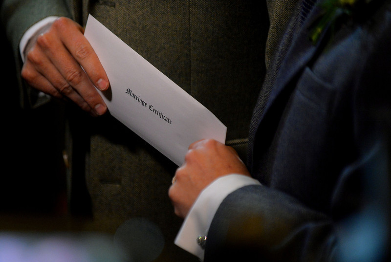 . Andrew Wale (L) and Neil Allard (R) hold an envelope containing their marriage certificate during their wedding ceremony at the Royal Pavillion in Brighton early on March 29, 2014.  The ceremony is one of several same-sex marriages taking place in Britain as a change in the law came into effect at midnight.  (LEON NEAL/AFP/Getty Images)
