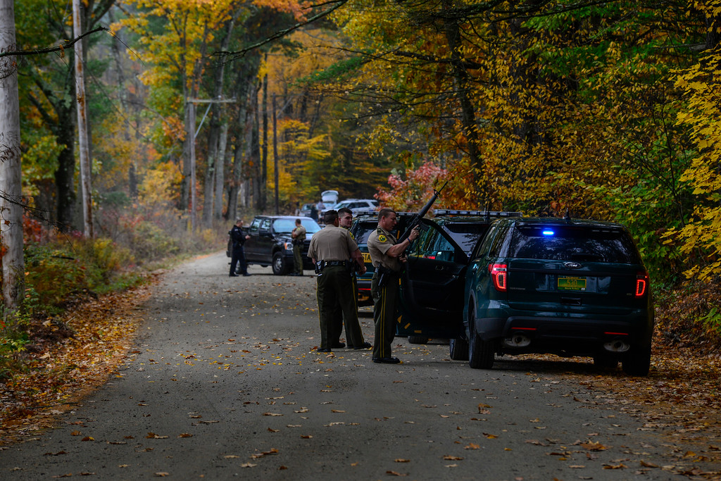 . Vermont State Police and various local police agencies investigate an abandoned Mitsubishi Eclipse on Plains Road in Weathersfield, Vt., on Tuesday, Oct. 18, 2016. Springfield Police responded to a armed robbery around 12:30p.m. at Windsor County South Credit Union on 383 River St. in Springfield. Police are actively searching for the suspect in connection to the bank robbery and motor vehicle theft.