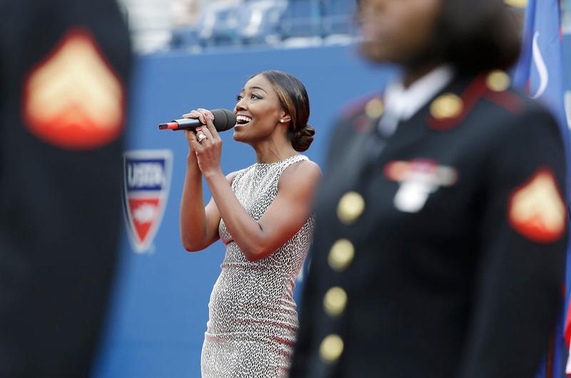 . Tony Award winner Patina Miller sings the national anthem before the start of the championship match of the 2014 U.S. Open tennis tournament between Kei Nishikori, of Japan, and Marin Cilic, of Croatia, Monday, Sept. 8, 2014, in New York. (AP Photo/Darron Cummings)