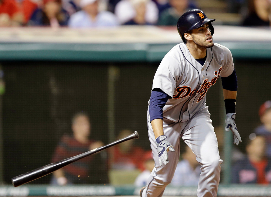 . Detroit Tigers\' J.D. Martinez watches his ball after hitting a three-run home run off Cleveland Indians relief pitcher John Axford in the eighth inning of a baseball game on Friday, June 20, 2014, in Cleveland. Tigers\' Miguel Cabrera and Victor Martinez also scored on the hit. (AP Photo/Tony Dejak)