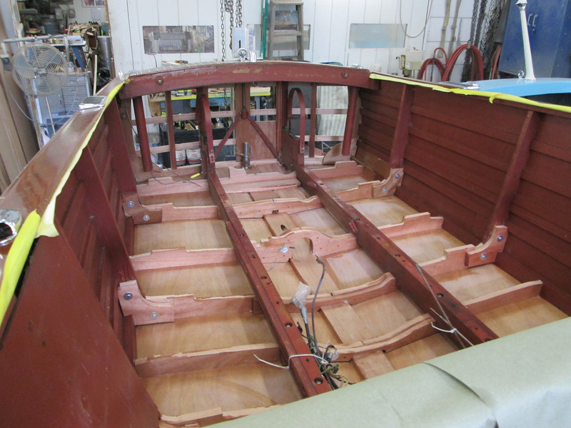 View looking toward the transom of new frames and bottom from the inside.