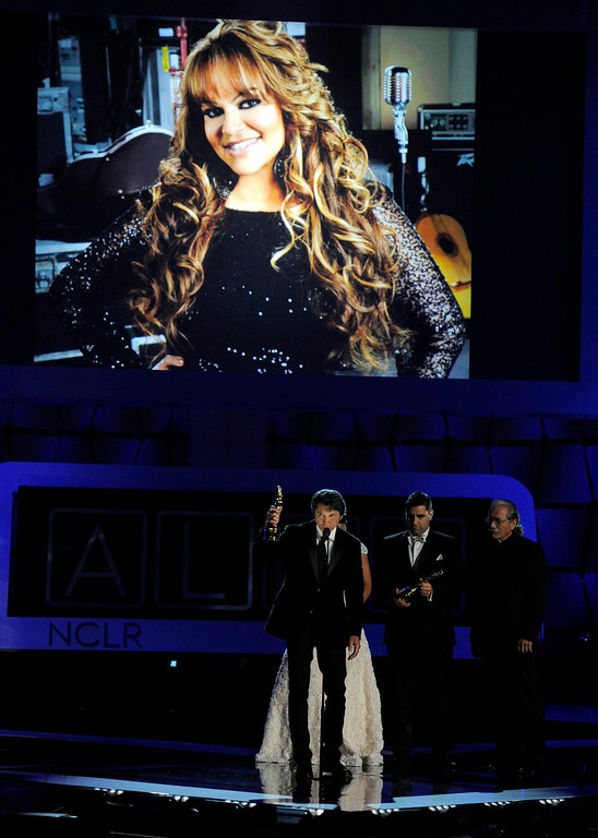 ". The cast of ""Filly Brown\"" presents a tribute to Jenni Rivera, seen on screen, at the NCLR ALMA Awards at the Pasadena Civic Auditorium on Friday, Sept. 27, 2013, in Pasadena, Calif. (Photo by Chris Pizzello/Invision/AP)"
