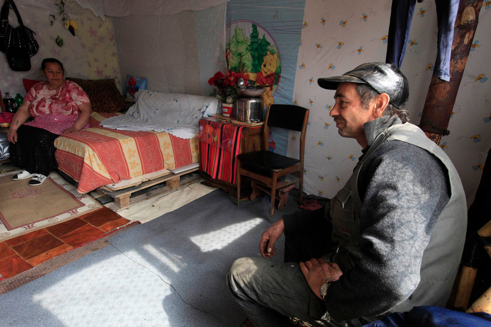 . Roma woman Maria and her husband Virgil pose for a portrait inside their shelter in an illegal camp in Lille, northern France, on International Roma Day on April 8, 2013.   REUTERS/Pascal Rossignol