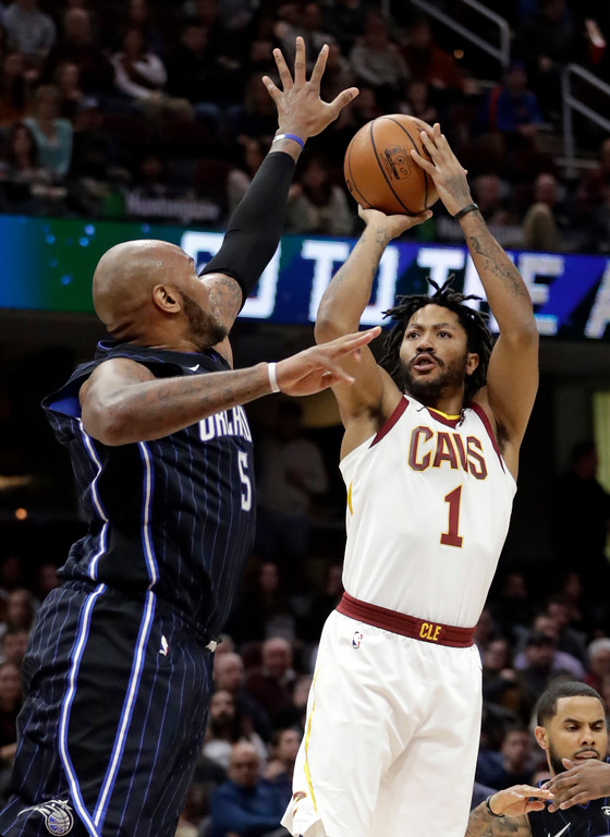 . Cleveland Cavaliers\' Derrick Rose (1) shoots over Orlando Magic\'s Marreese Speights (5) during the first half of an NBA basketball game Thursday, Jan. 18, 2018, in Cleveland. (AP Photo/Tony Dejak)