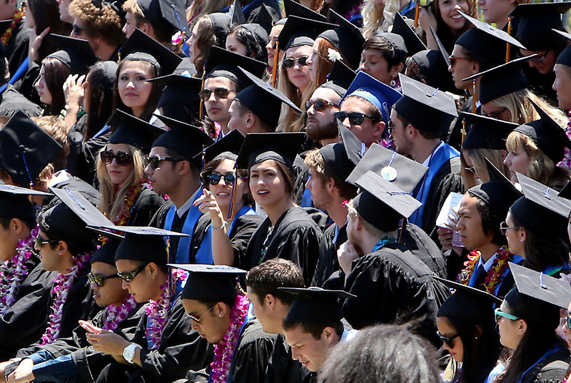. Hundreds of UC Santa Cruz Graduates fill the stands at the lower west field on Saturday for the College Eight graduation ceremony. (Kevin Johnson/Sentinel)