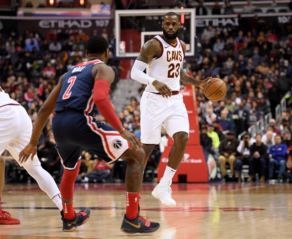 . Cleveland Cavaliers forward LeBron James (23) dribbles against Washington Wizards guard John Wall (2) during the first half of an NBA basketball game, Sunday, Dec. 17, 2017, in Washington. (AP Photo/Nick Wass)