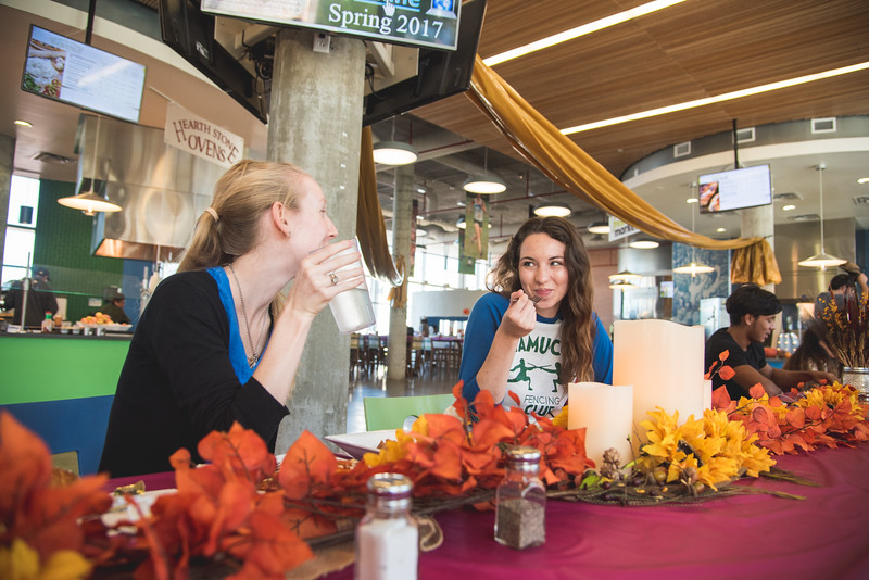Zoey Seal (left) and Rene Pearl have a festive turkey meal for lunch during the dining hall's Turkey for a Cause event.