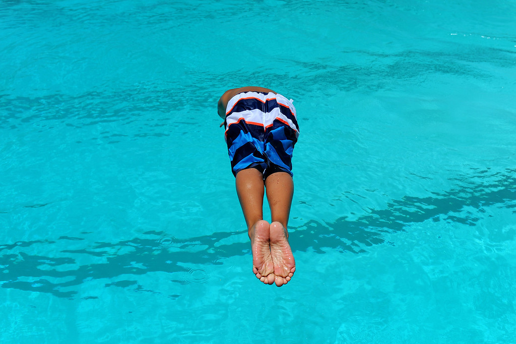. George Rodriguez, 10, dives into the pool at Lanark Park in Canoga Park, Saturday, June 14, 2014. (Photo by Michael Owen Baker/Los Angeles Daily News)