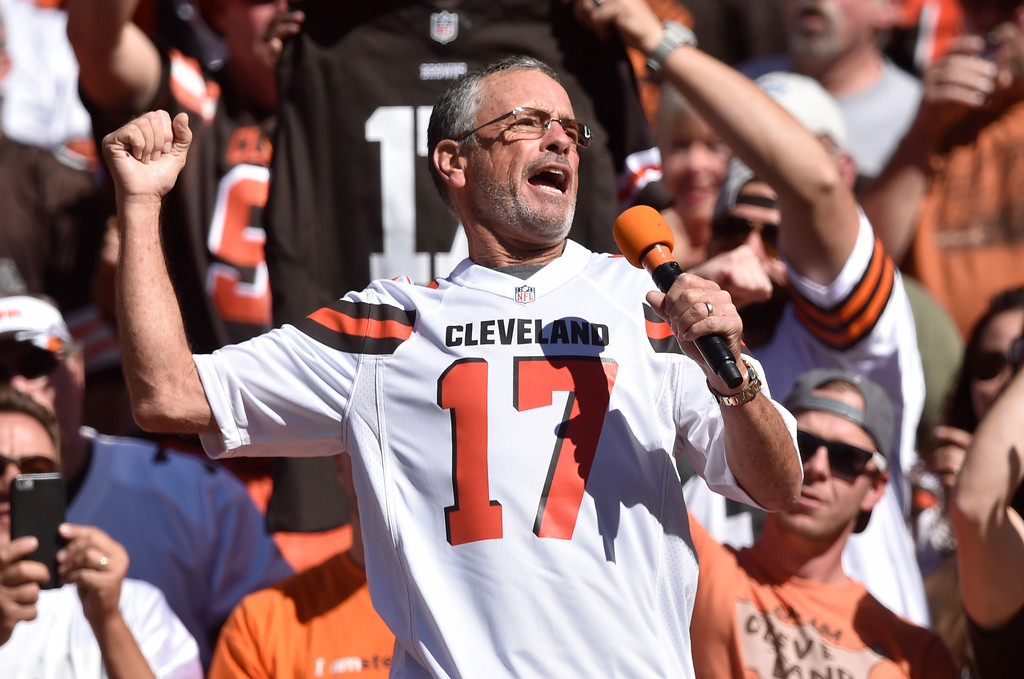 . Former Cleveland Browns quarterback Brian Sipe cheers for the Browns in the first half of an NFL football game against the Cincinnati Bengals, Sunday, Oct. 1, 2017, in Cleveland. (AP Photo/David Richard)