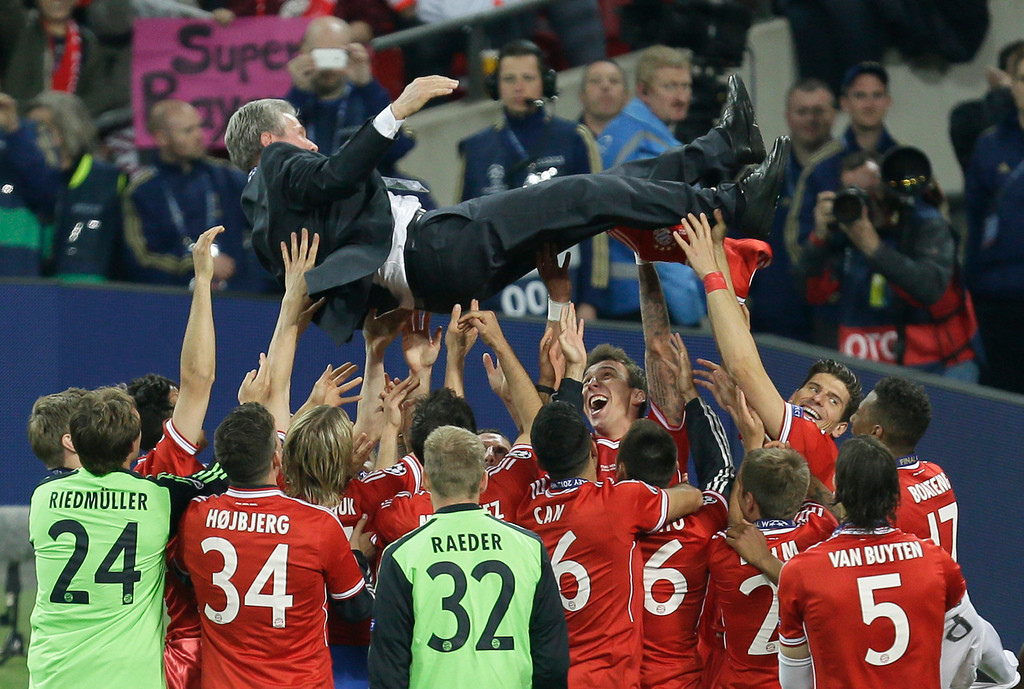 . Bayern head coach Jupp Heynckes is celebrated by his players after winning the Champions League Final soccer match between  Borussia Dortmund and Bayern Munich at Wembley Stadium in London, Saturday May 25, 2013. (AP Photo/Alastair Grant, File)