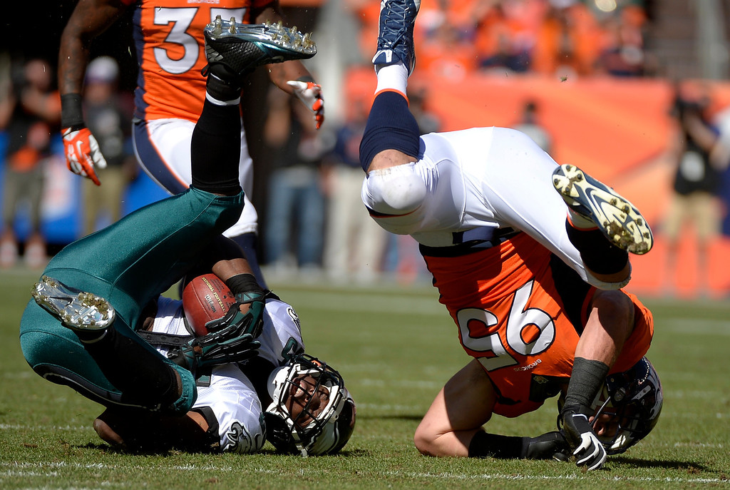 . DENVER, CO - SEPTEMBER 29: Denver Broncos defensive end Derek Wolfe (95) crushes Philadelphia Eagles running back LeSean McCoy (25) during the first quarter. The Denver Broncos took on the Philadelphia Eagles at Sports Authority Field at Mile High in Denver on September 29, 2013. (Photo by Joe Amon/The Denver Post)
