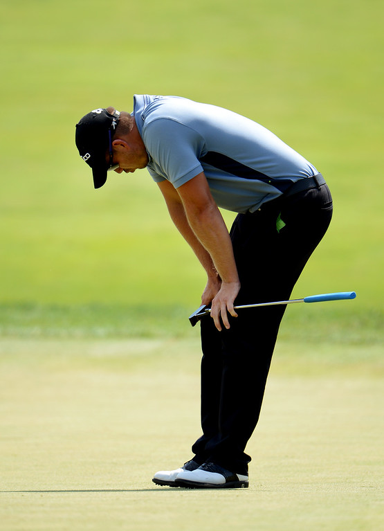 . Henrik Stenson of Sweden reacts to a missed putt for eagle on the fourth green during Round Three of the 113th U.S. Open at Merion Golf Club on June 15, 2013 in Ardmore, Pennsylvania.  (Photo by David Cannon/Getty Images)