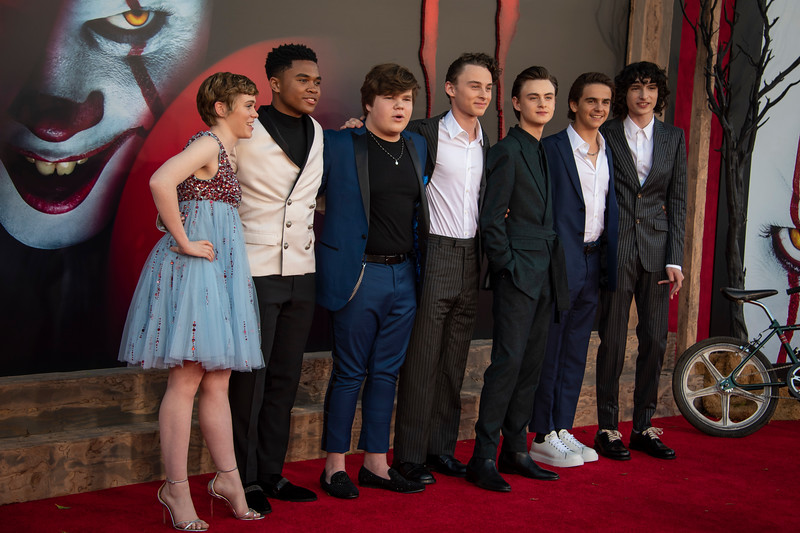 """WESTWOOD, CA - AUGUST 26: Sophia Lillis, Chosen Jacobs, Jeremy Ray Taylor, Wyatt Oleff, Jaeden Martell, Jack Dylan Grazer and Finn Wolfhard attend the Premiere Of Warner Bros. Pictures' """"It Chapter Two"""" at Regency Village Theatre on Monday, August 26, 2019 in Westwood, California. (Photo by Tom Sorensen/Moovieboy Pictures)"""