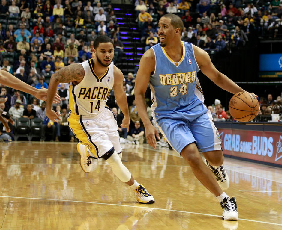 . Denver Nuggets guard Andre Miller (24) gets around Indiana Pacers guard D.J. Augustin (14) during the third quarter of an NBA basketball game in Indianapolis, Indiana December 7, 2012.  REUTERS/Brent Smith