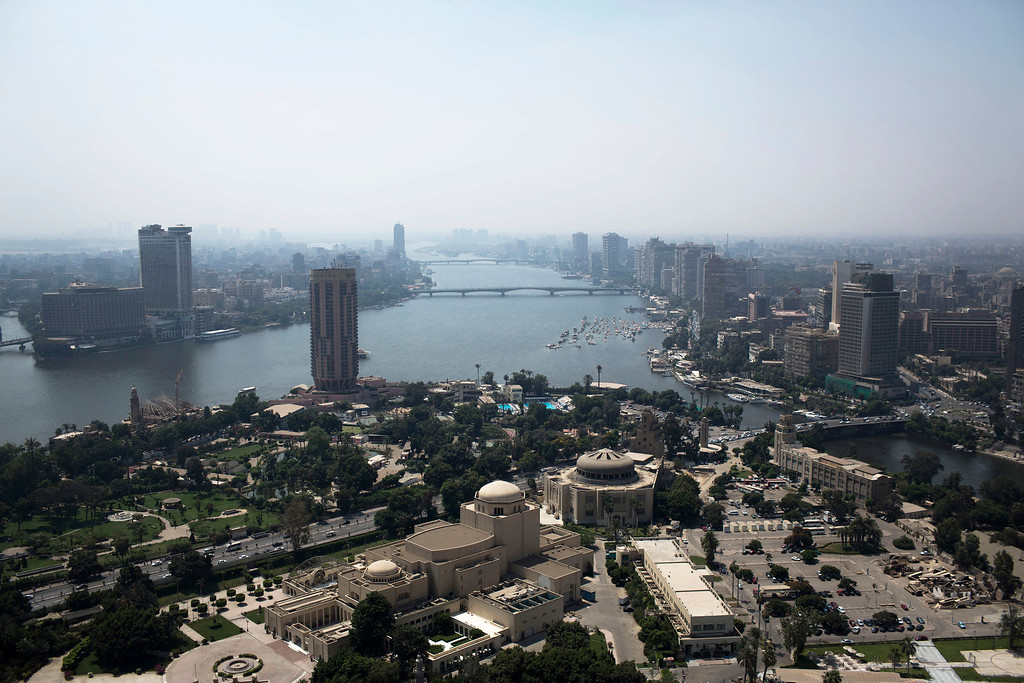 . A general view of the Nile River and the Cairo skyline is seen from the Cairo Tower in Cairo Tower in the Zamalek district Tuesday, Aug. 27, 2013. The chairman of the Egyptian Airports Co. says some flights are arriving nearly empty to Egypt and that passenger traffic in the past week has fallen by half. In a statement released Monday, the chairman said Egypt will likely see an even steeper decline in the number of visitors by next month. A number of airlines have canceled their flights entirely, but Nasr did not disclose how many. (AP Photo/Manu Brabo)