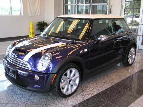 "Just one more look at the ""purple haze metallic"" MINI before finalizing the paperwork."