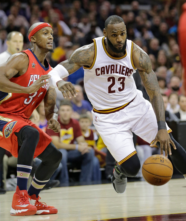 . Cleveland Cavaliers\' LeBron James (23) drives against New Orleans Pelicans\' Dante Cunningham (33) in the first half of an NBA basketball game, Monday, Jan. 2, 2017, in Cleveland. (AP Photo/Tony Dejak)