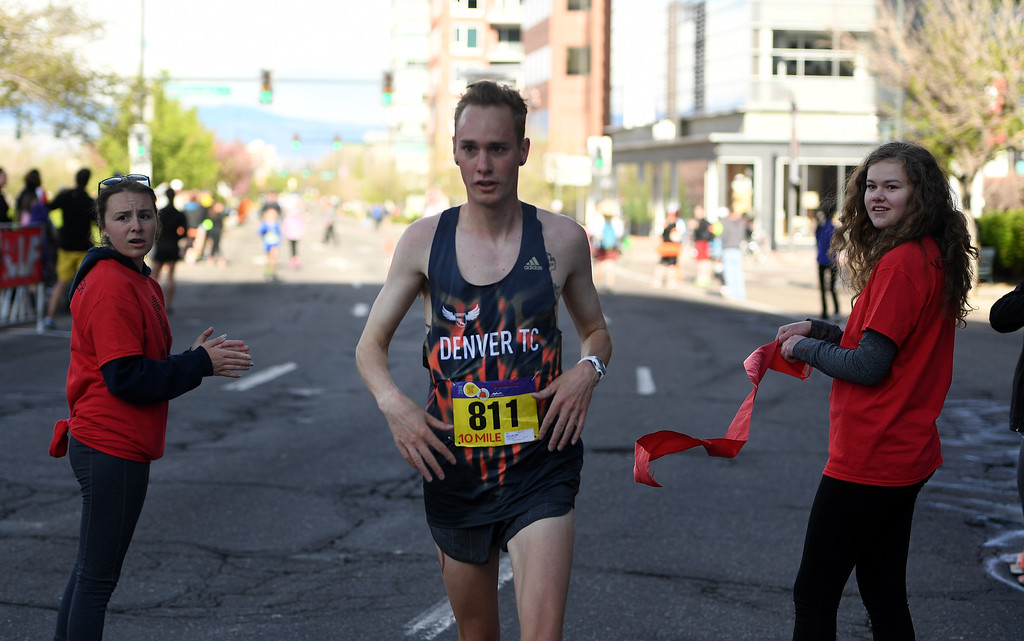 . DENVER, CO - APRIL 24:  Runner Ian Butler crosses the finish line of the 10 mile race during of the 34th annual Cherry Creek Sneak road races on April 24, 2016 in Denver, Colorado. The day\'s races included a 10 miler, a 1.5 mile Sneak Sprint, a 5K and a 5 mile run and walk.   (Photo by Helen H. Richardson/The Denver Post)