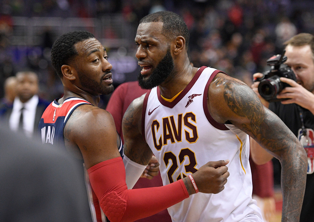 . Cleveland Cavaliers forward LeBron James (23) greets Washington Wizards guard John Wall (2) after an NBA basketball game, Sunday, Dec. 17, 2017, in Washington. (AP Photo/Nick Wass)