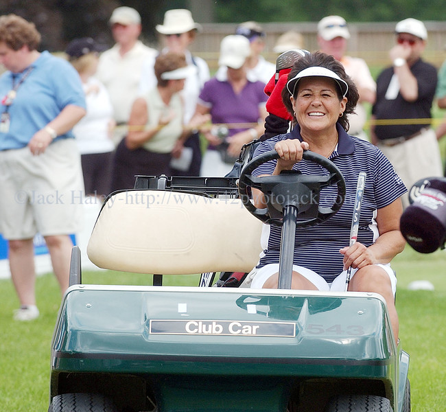 jhgolf12 Despite a bit of  a struggle on the course, Nancy Lopez has a smile as fans  encourage her on.