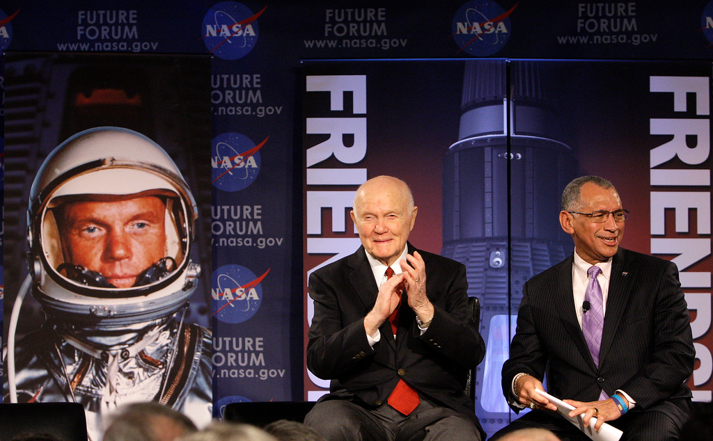 """. Sen. John Glenn, left, and Charles Bolden, administrator from NASA headquarters, talk, via satellite, with the astronauts on the International Space Station, before the start of a roundtable discussion titled \""""Learning from the Past to Innovate for the Future\"""" Monday, Feb. 20, 2012, in Columbus, Ohio. Glenn was the first American to orbit Earth, piloting Friendship 7 around it three times in 1962, and also became the oldest person in space, at age 77, by orbiting Earth with six astronauts aboard shuttle Discovery in 1998. (AP Photo/Jay LaPrete)"""