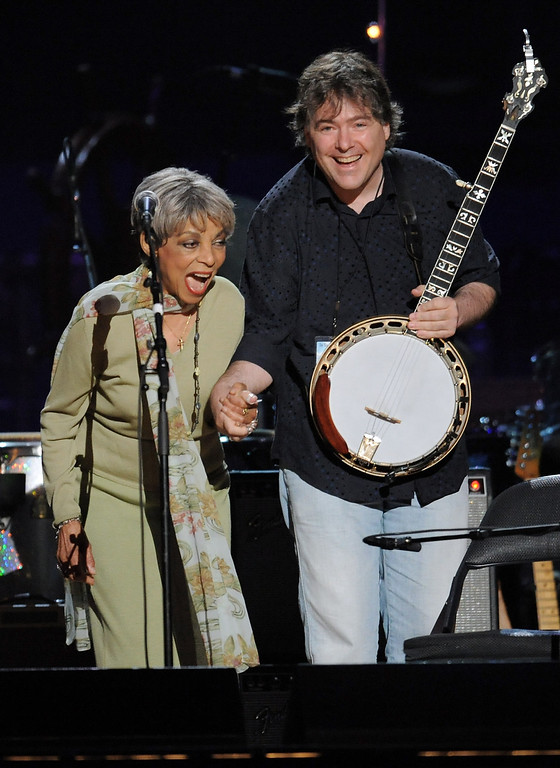 . Actress Ruby Dee and musician Bela Fleck performs at a benefit concert celebrating Pete Seeger\'s 90th birthday at Madison Square Garden on Sunday, May 3, 2009 in New York. The concert is a benefit for Hudson River Sloop Clearwater, created by Seeger to preserve and protect the Hudson River. (AP Photo/Evan Agostini)