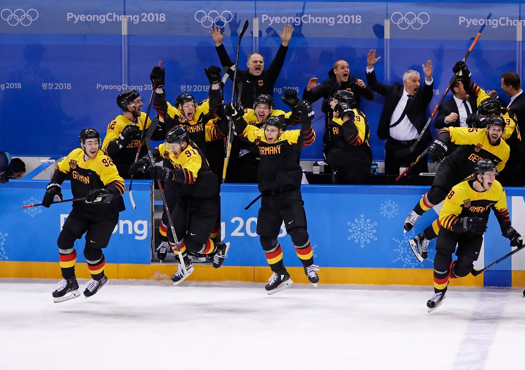. Germany celebrates after a video review determined that Patrick Reimer,scored a goal during the overtime period of the quarterfinal round of the men\'s hockey game against Sweden at the 2018 Winter Olympics in Gangneung, South Korea, Wednesday, Feb. 21, 2018. (AP Photo/Frank Franklin II)