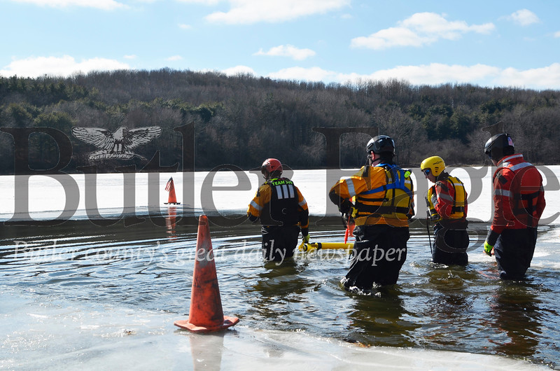 Butler County Water Rescue Team 300 wades into the icy Lake Arthur Satuday to assist with the Douse for House fundraising event at Moraine State Park in Muddy Creek Township. The event raised $17,500 that would be used for three homes, according to the Lawrence County Habitat for Humanity. Tanner Cole/Butler Eagle
