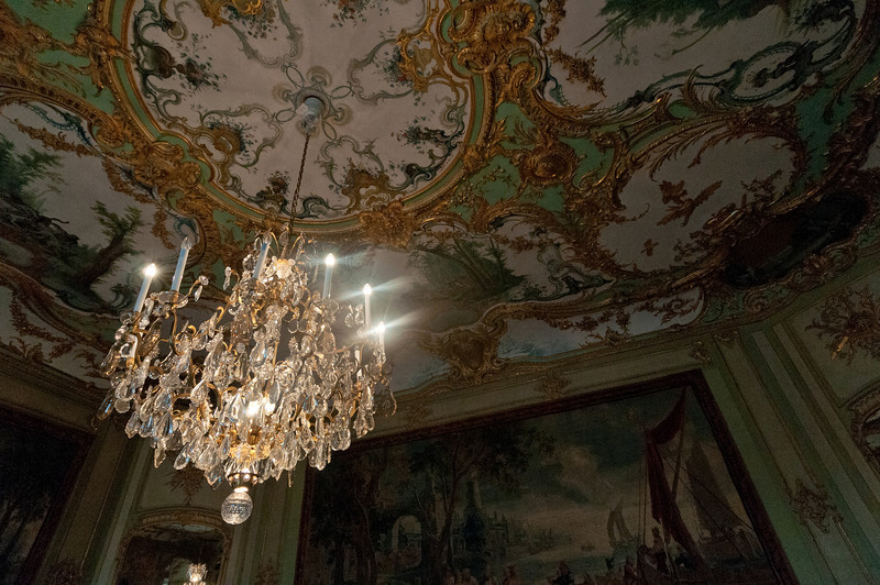 Chandelier and colorful ceiling in Augustusburg Palace, Germany