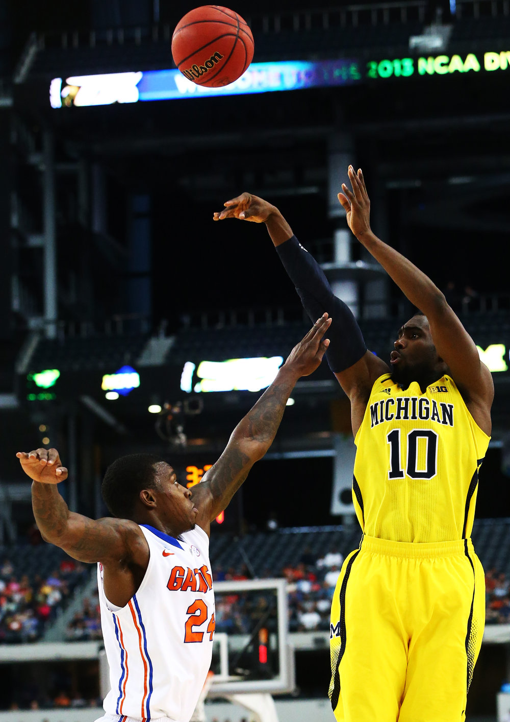 . Tim Hardaway Jr. #10 of the Michigan Wolverines goes up for a three pointer over Casey Prather #24 of the Florida Gators in the first half during the South Regional Round Final of the 2013 NCAA Men\'s Basketball Tournament at Dallas Cowboys Stadium on March 31, 2013 in Arlington, Texas.  (Photo by Ronald Martinez/Getty Images)