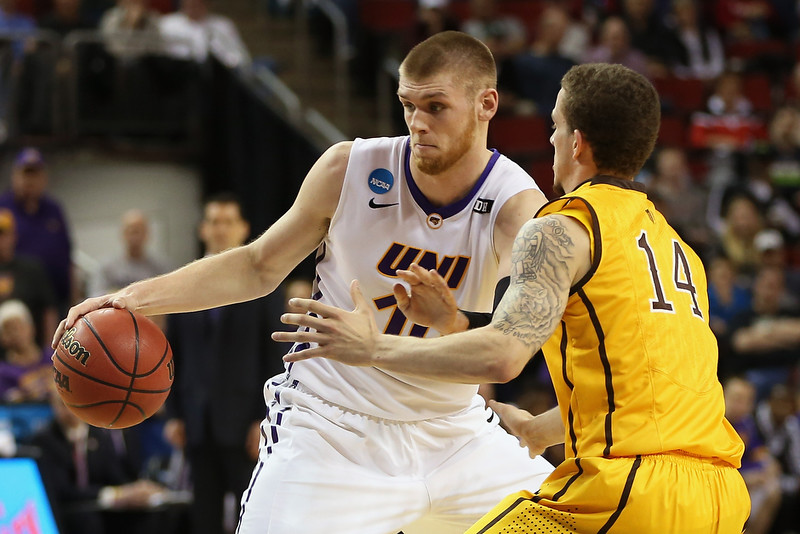 . Seth Tuttle #10 of the Northern Iowa Panthers drives against Josh Adams #14 of the Wyoming Cowboys during the second round of the 2015 Men\'s NCAA Basketball Tournament at KeyArena on March 20, 2015 in Seattle, Washington.  (Photo by Otto Greule Jr/Getty Images)
