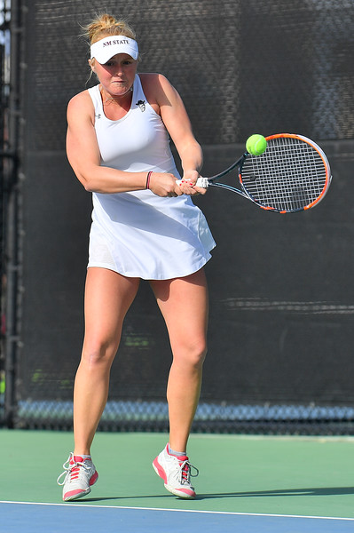 LAS VEGAS, NV - JANUARY 20:  Lindsay Harlas of the New Mexico State Aggies plays a backhand during her match against Tereza Pilzova of the Weber State Wildcats at the Frank and Vicki Fertitta Tennis Complex in Las Vegas, Nevada. Harlas won the match 4-6, 7-5, 1-0 (10-5).
