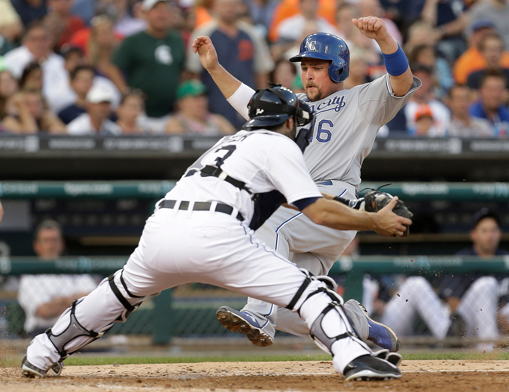 . Kansas City Royals designated hitter Billy Butler (16) is tagged out sliding into home plate by Detroit Tigers catcher Alex Avila (13) in the fifth inning of a baseball game in Detroit, Monday, June 16, 2014.  (AP Photo/Paul Sancya)