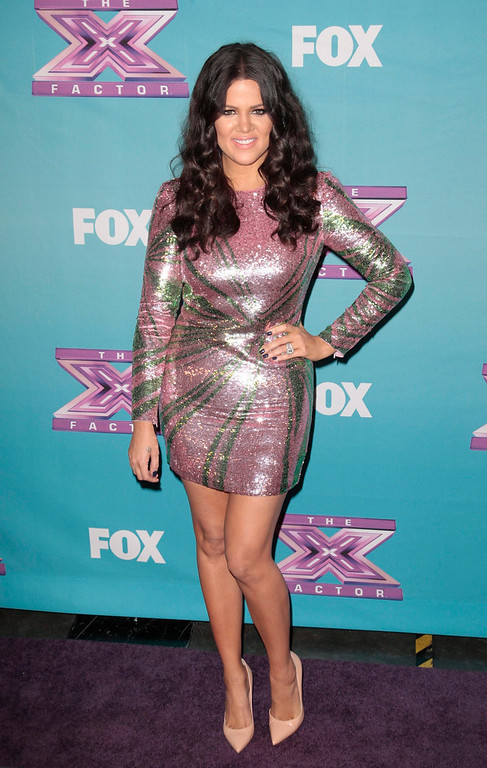 ". Television personality Khloe Kardashian Odom poses following Fox\'s ""The X Factor\"" Season Finale - Night 2 at CBS Television City in Los Angeles, California December 20, 2012. REUTERS/Jason Redmond"