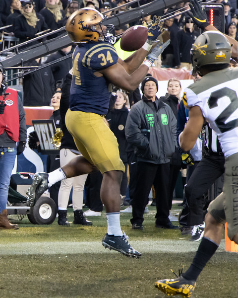Fullback #34 Jamaie Carothers catches a pass in the endzone for a Navy touchdown.