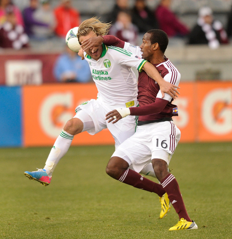 . Atiba Harris (16) of the Colorado Rapids competed for the ball with Michael Harrington (5) of the Portland Timbers in the second half. The Colorado Rapids tied the Portland Timbers 2-2 Saturday, March 30, 2013 at Dick\'s Sporting Goods Park in Commerce City.  Photo By Karl Gehring/The Denver Post)