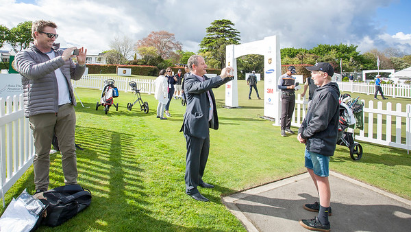 15 yr old Ben Burgess (caddy) being interviewed by Simon Woolf while dad, Garey Burgess looks on at Practice Day 1 of the Asia-Pacific Amateur Championship tournament 2017 held at Royal Wellington Golf Club, in Heretaunga, Upper Hutt, New Zealand from 26 - 29 October 2017. Copyright John Mathews 2017.   www.megasportmedia.co.nz