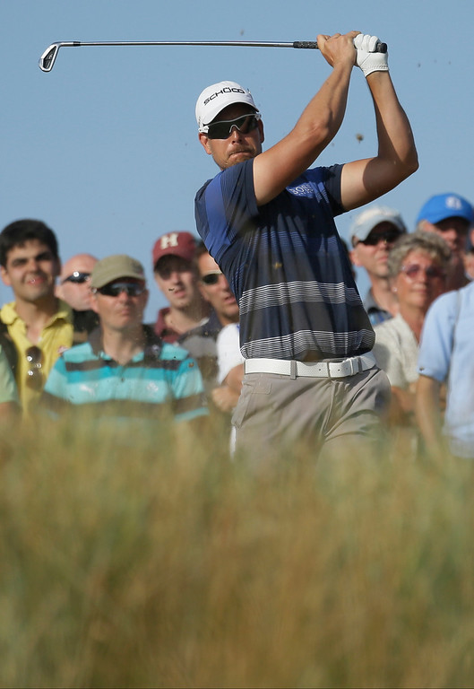 . Henrik Stenson of Sweden plays a shot off the 14th tee during the third round of the British Open Golf Championship at Muirfield, Scotland, Saturday July 20, 2013. (AP Photo/Jon Super)